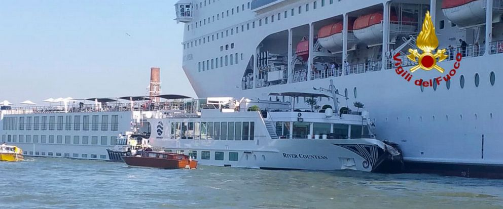 In this photo released by the Italian Firefighters, the MSC Opera cruise liner, a towering cruise ship, strikes a tourist river boat, left, Sunday, June 2, 2019, in Venice, Italy, injuring at least five people. The collision happened at about 8:30 a.