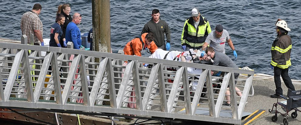 Emergency response crews transport an injured passenger to an ambulance at the George Inlet Lodge docks, Monday, May 13, 2019, in Ketchikan, Alaska. The passenger was from one of two float planes reported down in George Inlet early Monday afternoon a