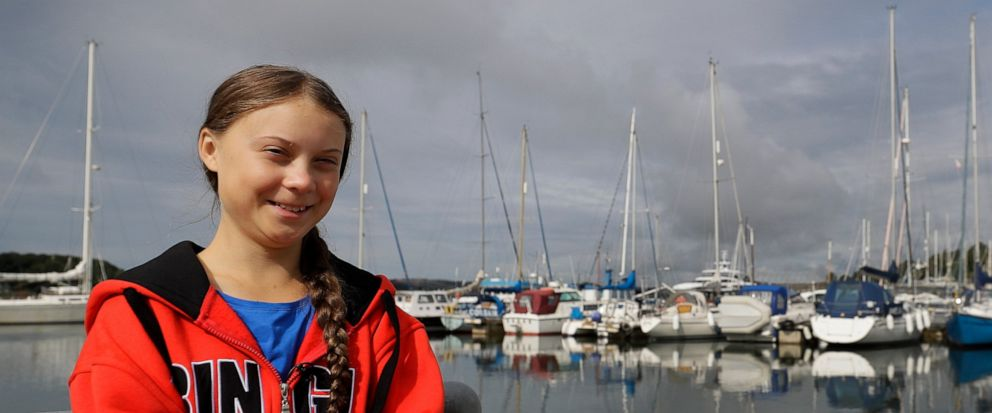 Greta Thunberg poses for a picture in the Marina where the boat Malizia is moored in Plymouth, England Tuesday, Aug. 13, 2019. Greta Thunberg, the 16-year-old climate change activist who has inspired student protests around the world, is heading to t