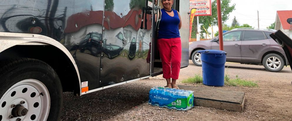 In this Aug. 1, 2019 photo Nena Hermosillo stands outside her taco truck in Cheyenne, Wyo. Cheyenne-based Taco Johns, which has nearly 400 locations in 23 states, recently sent Freedoms Edge Brewing Co. in Cheyenne a cease-and-desist letter for usi