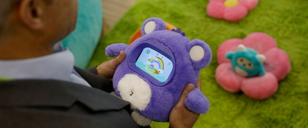 A man holds a Woobo talking robot at the Woobo booth at CES International, Wednesday, Jan. 9, 2019, in Las Vegas. (AP Photo/John Locher)