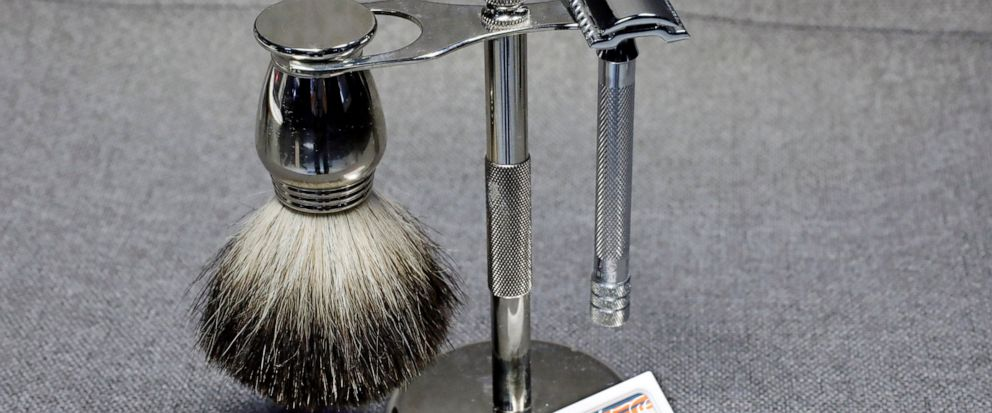 This photo, in New York, Tuesday, Aug. 6, 2019, shows a Col. Ichabod Conk shave set and Merkur double-edge razor blades. Remember the old-school safety razor your grandfather used? It's making a comeback. Trendy direct-to-consumer brands have reintro