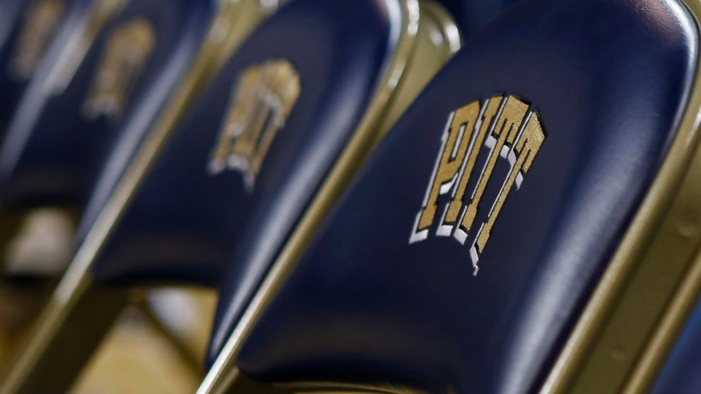 """FILE- This Jan. 8, 2015, file photo shows a row of chairs with the """"Pitt"""" logo, for the University of Pittsburgh before an NCAA college basketball game in Pittsburgh. The University of Pittsburgh is offering graduating seniors up to $5,000 in federal student loan relief with one request: They pay it forward. The school's new program, Panthers Forward, will help recent graduates chip away at student debt and introduce them to alumni mentors to encourage professional development. Students have no obligation to repay the gift, but the university is encouraging recipients to make financial contributions to sustain the program. (AP Photo/Keith Srakocic, File)"""