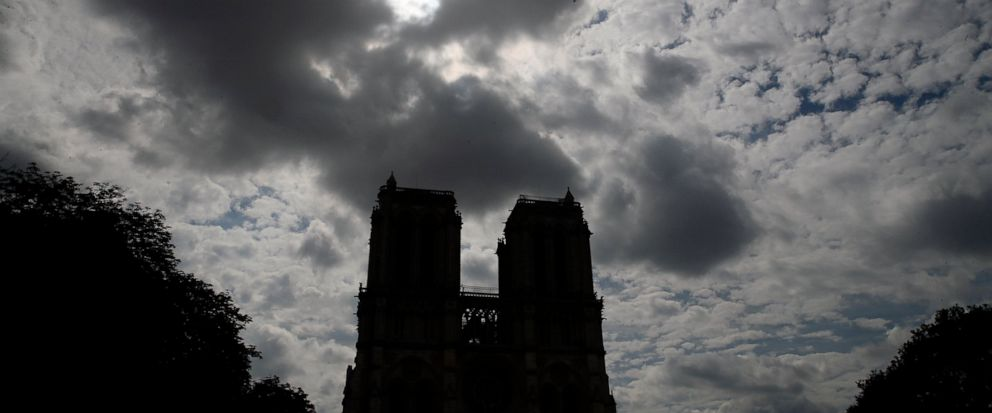 Notre Dame cathedral is silhouetted as environmental groups and unionists attend a news conference to warn against lead particles polluting the air in the area, and ask for a regularly updated chart showing pollution levels in Paris, France, Monday,