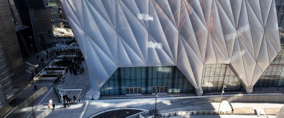 FILE - This April 1, 2019 file photo shows The Shed, the latest addition to Hudson Yards, in New York. The building is a new arts space consisting of a stationary building with a a shell constructed around it that can move in a matter of minutes to c