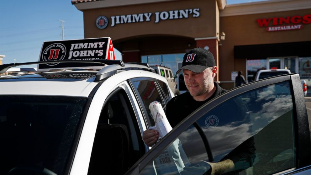 In this Wednesday, Feb. 6, 2019, photo, Tyler Schwecke, a delivery driver for Jimmy John's, gets in his car to make a delivery in Las Vegas. Food delivery services like Uber Eats and GrubHub are taking off like a rocket, but some restaurants aren't on board. This week, Jimmy John's sandwich chain launched a national ad campaign promising never to use third-party delivery. (AP Photo/John Locher)