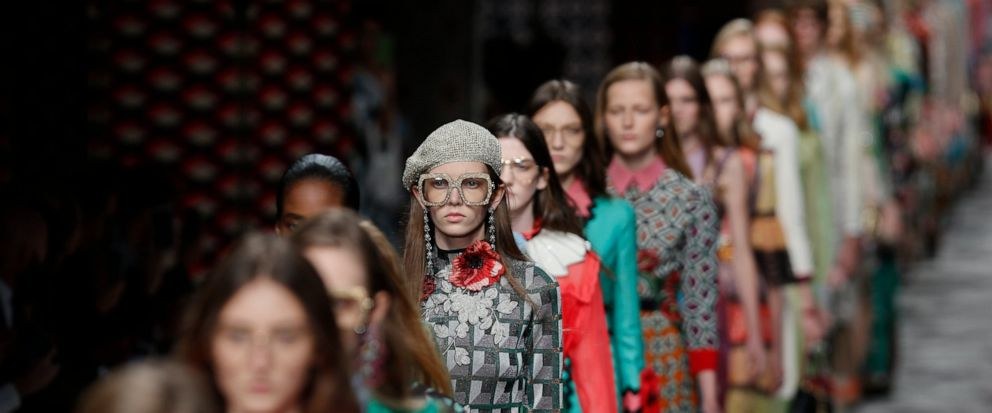 FILE - In this Sept. 23, 2015 file photo, models wear creations for Gucci womens Spring-Summer 2016 collection, part of the Milan Fashion Week, unveiled in Milan, Italy. Italian fashion house Gucci is launching $1.5 million in U.S. university schola