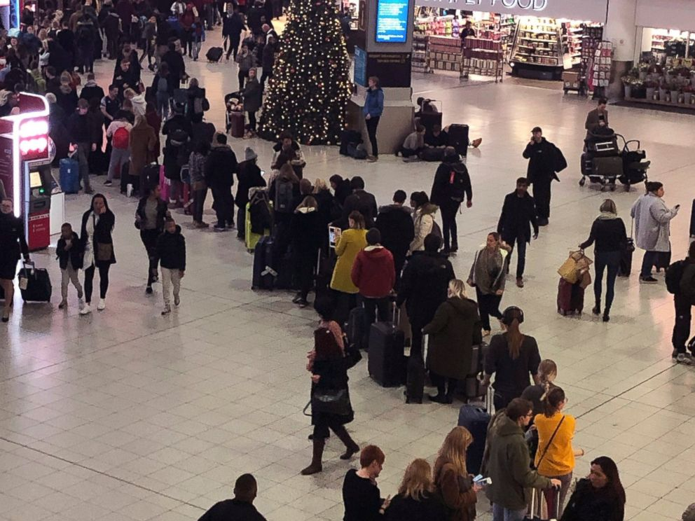 Queues of passengers cross a concourse in Gatwick Airport, as the airport remains closed with incoming flights delayed or diverted to other airports, after drones were spotted over the airfield last night and this morning Thursday Dec. 20, 2018. Lond