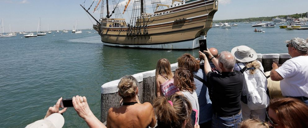 FILE - In this June 6, 2016, file photo, people on a wharf watch as the Mayflower II, the 1957 replica of the famed ship that carried the Pilgrims to Massachusetts in 1620, as it arrives in Plymouth Harbor in Plymouth, Mass. The replica vessel will s