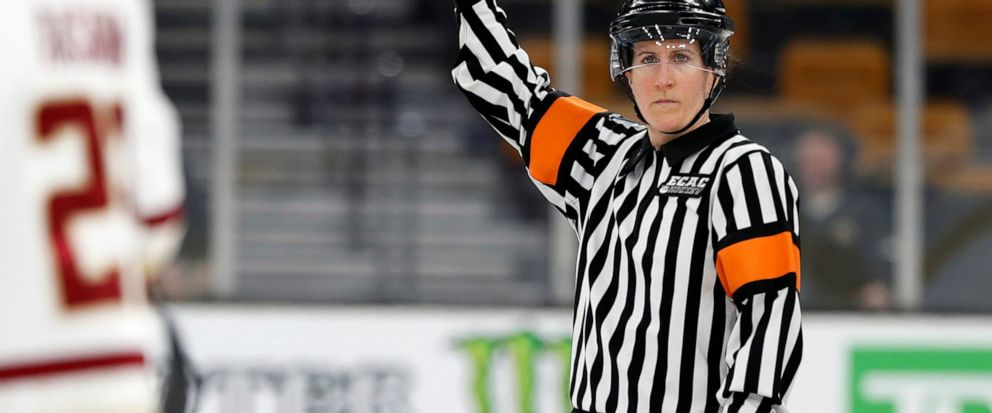 FILE - In this Feb 4, 2019, file photo, referee Katie Guay watches a Boston College line change during a Beanpot Tournament NCAA college hockey game against Harvard in Boston. Guay and Kirsten Walsh were among four females selected by the NHL on Frid