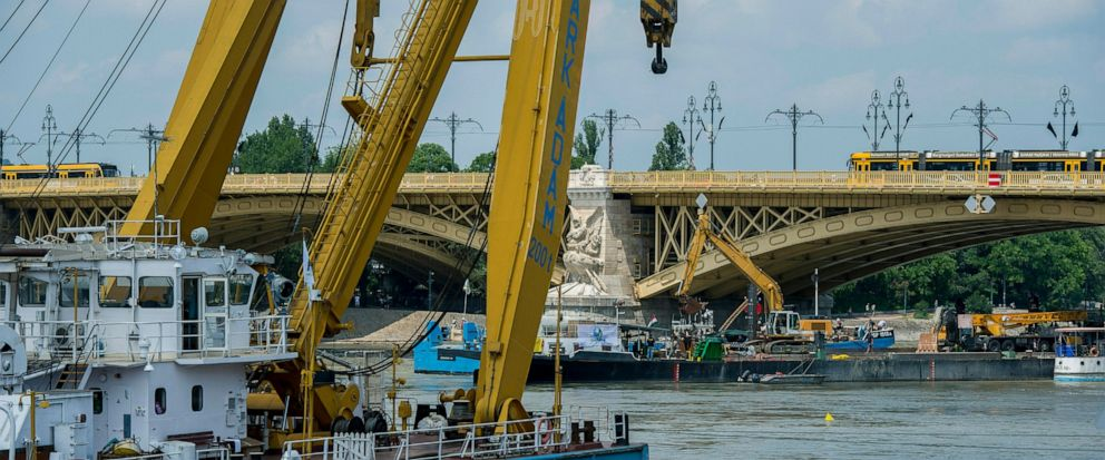 Preparations are made to lift the sunk shipwreck at Margaret Bridge, the scene of the deadly boat accident in Budapest, Hungary, Monday, June 10, 2019. A sightseeing boat carrying 33 South Korean tourists was crashed by a large river cruise ship and