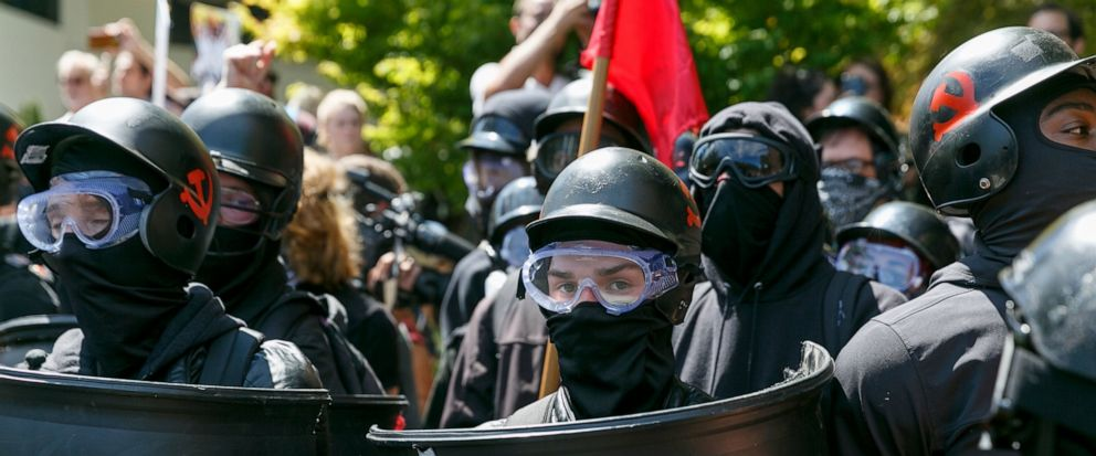 FILE - In this Aug. 4, 2018, file photo, counter-protesters prepare to clash with Patriot Prayer protesters during a rally in Portland, Ore. Portland police are mobilizing in hopes of avoiding clashes between out-of-state hate groups planning a rally