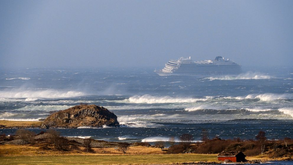 The cruise ship Viking Sky as it drifts after sending a Mayday signal because of engine failure in windy conditions near Hustadvika, off the west coast of Norway, Saturday March 23, 2019. The Viking Sky is forced to evacuate its estimated 1,300 passengers. (Odd Roar Lange / NTB scanpix via AP)
