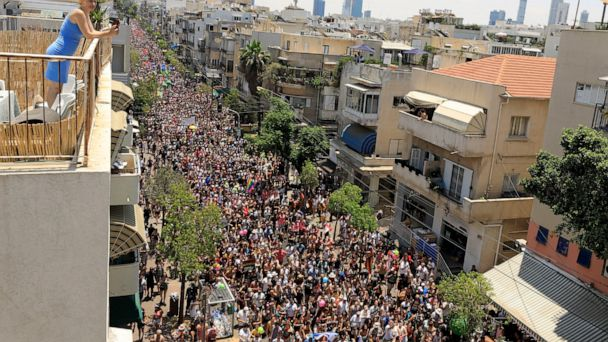 Pride parade kicks off in Tel Aviv with partyers, protesters