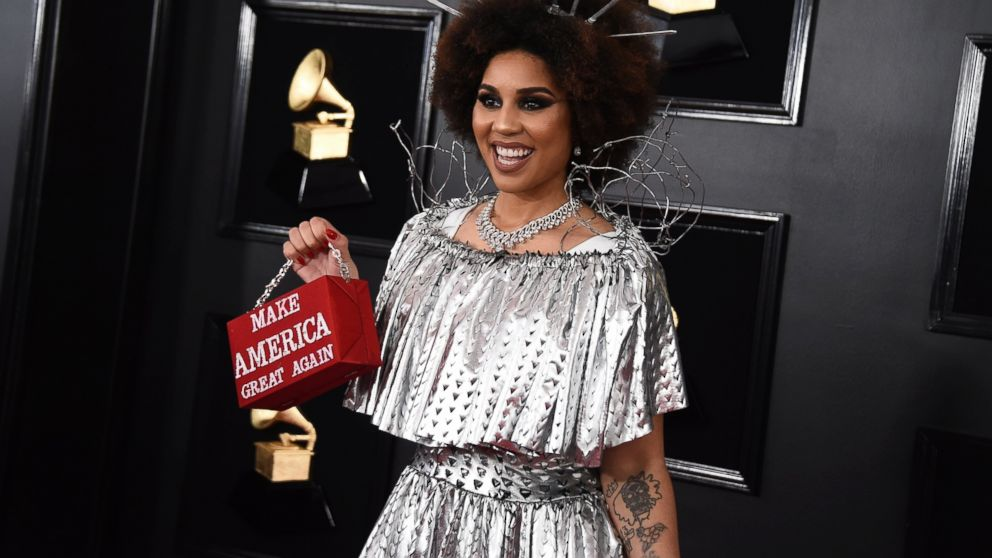 """Joy Villa holds a purse that reads """"Make America Great Again"""" at the 61st annual Grammy Awards at the Staples Center on Sunday, Feb. 10, 2019, in Los Angeles. (Photo by Jordan Strauss/Invision/AP)"""