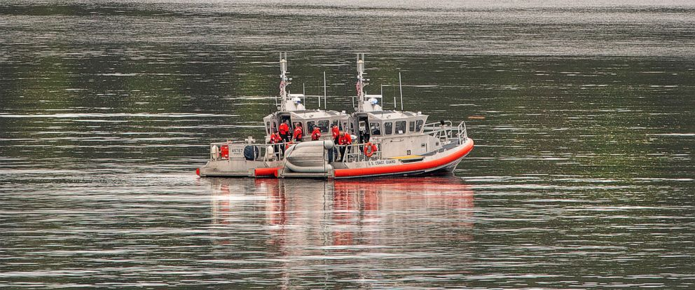 Two U.S. Coast Guard 45-foot response boats drift through George Inlet as part of a search effort on Tuesday, May 14, 2019, near Ketchikan, Alaska, at the site of a collision between two float planes. Dive teams plunged into the icy cold waters of th