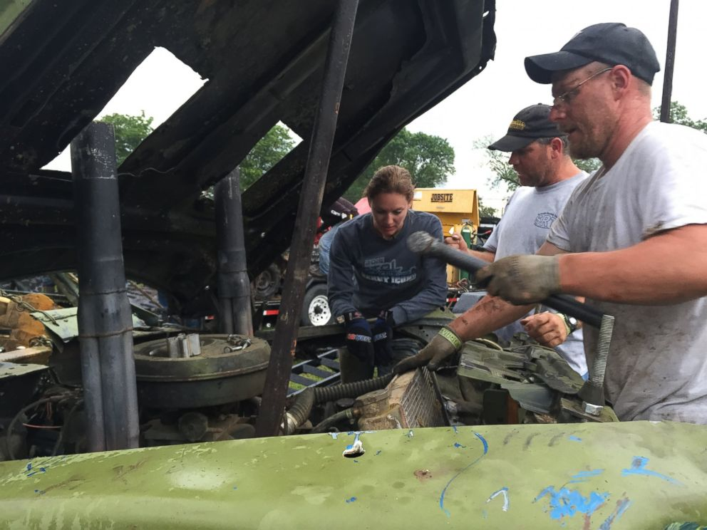 Kim Potocki preps her car with her husband Chris for the finals at Metal Mayhem 2015, a national demolition derby contest in Pecatonica, Illinois.