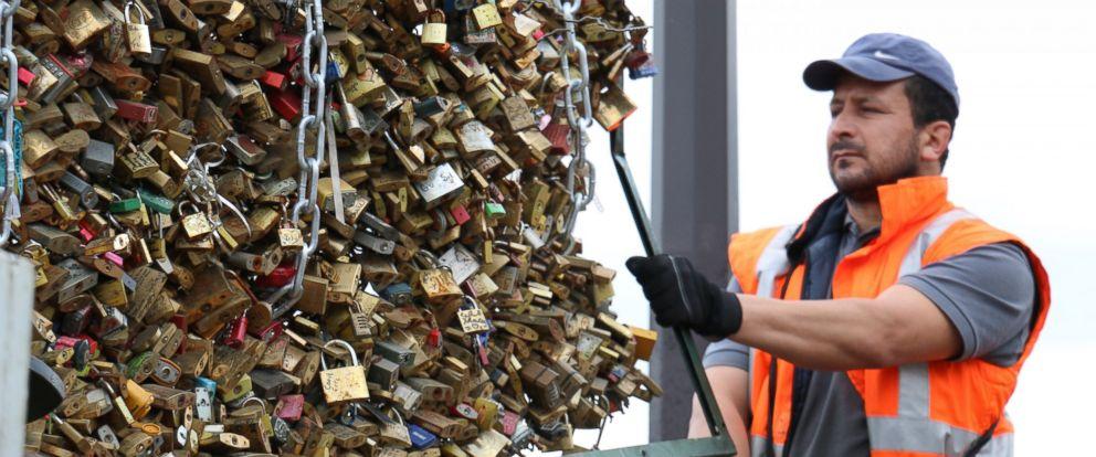 "PHOTO: Paris city officials have started to remove ""love locks"" fastened to Paris Pont des Arts bridge."