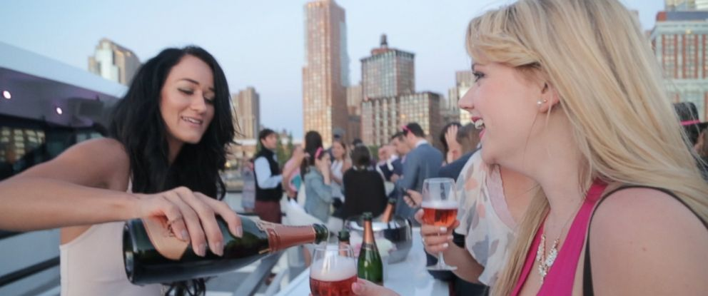 Guests enjoy glasses of pink bubbly at the La Nuit en Rosé, a New York City wine festival dedicated to Rosé wine.