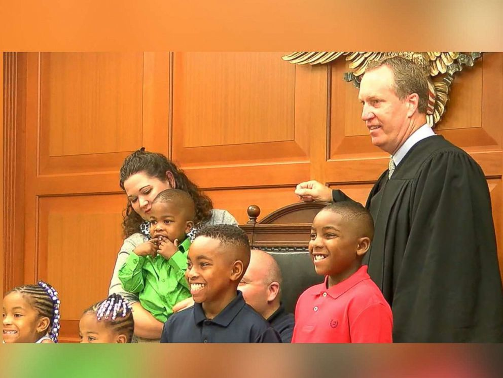 PHOTO:Julie and Will Rom officially became mom and dad to William, 12, Truth, 9, Marianna, 6, Keyora, 3, and KJ, 2, on July 27, 2017, at the Hamilton County Probate Court in Cincinnati.