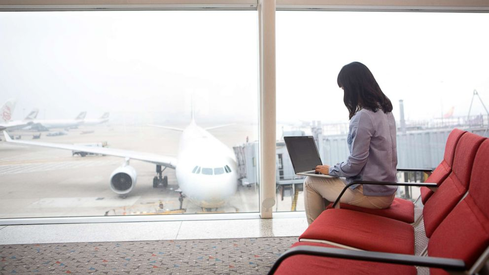 Woman at airport using laptop in an undated stock photo.