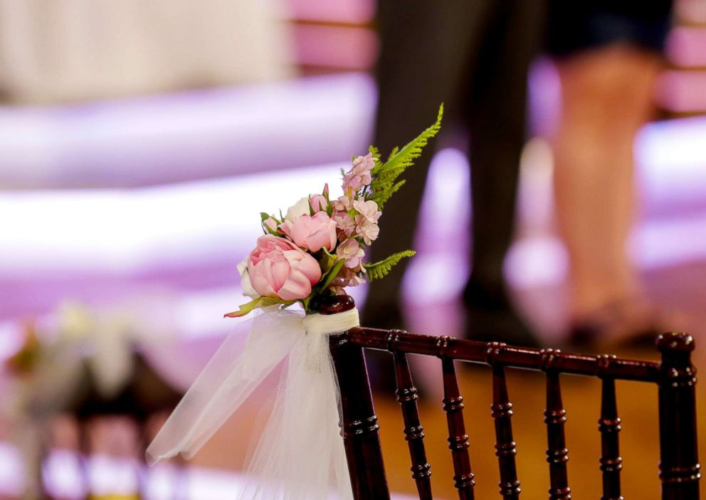 PHOTO: Chairs are decorated with flowers and tulle