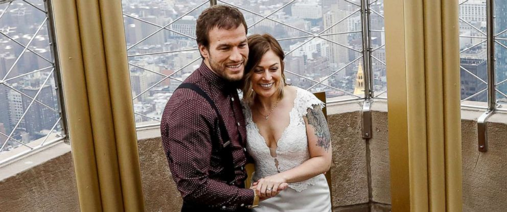 PHOTO: Alixandra and Brett Epps pose after renewing their vows at their Valentines Day ceremony at the top of the Empire State Building in New York, Feb. 14, 2018.