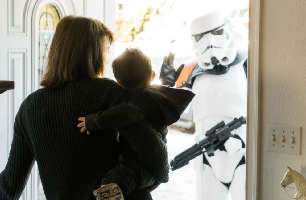 PHOTO: Ben Bronske and his mom, Sarah Bronske, greet Stormtroopers at their Washington state home. <p itemprop=