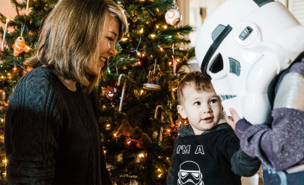 PHOTO: Ben Bronske greets a Stormtrooper while his mother, Sarah Bronske, looks on. <p itemprop=