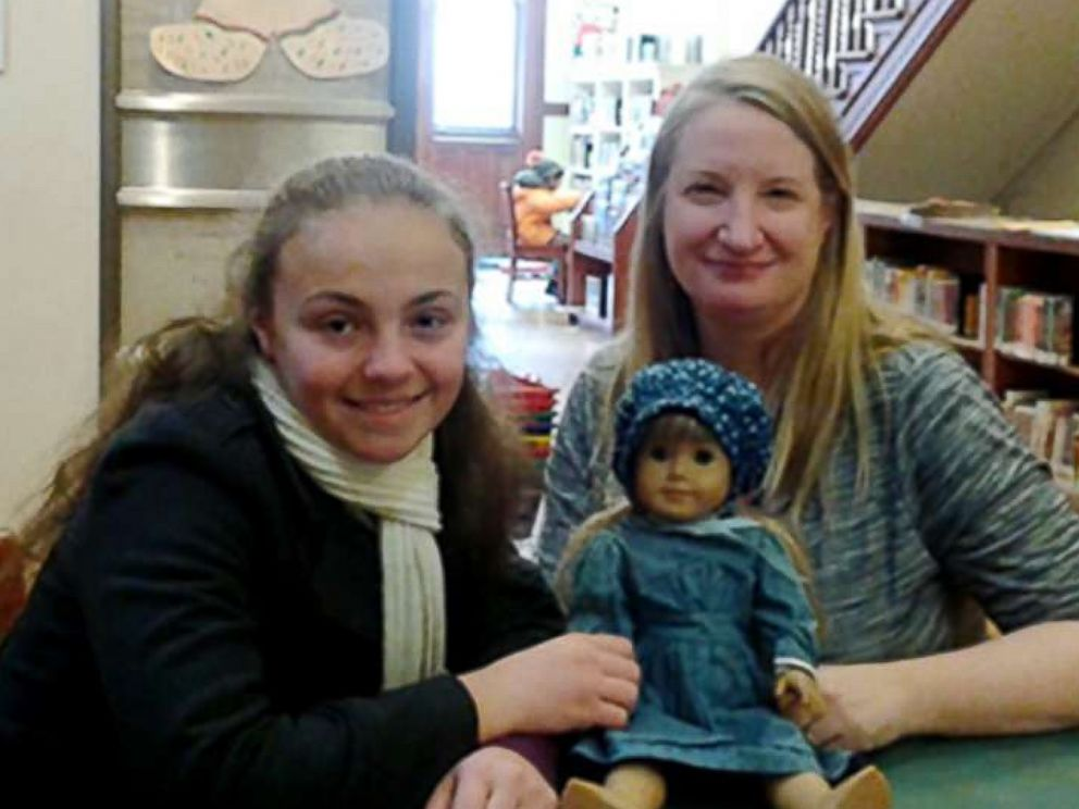 PHOTO: Olivia Reduto, left, poses with Thea Taube, Childrens Librarian at Ottendorfer Branch of the New York Public Library, whose American Girl dolls project inspired Reduto.
