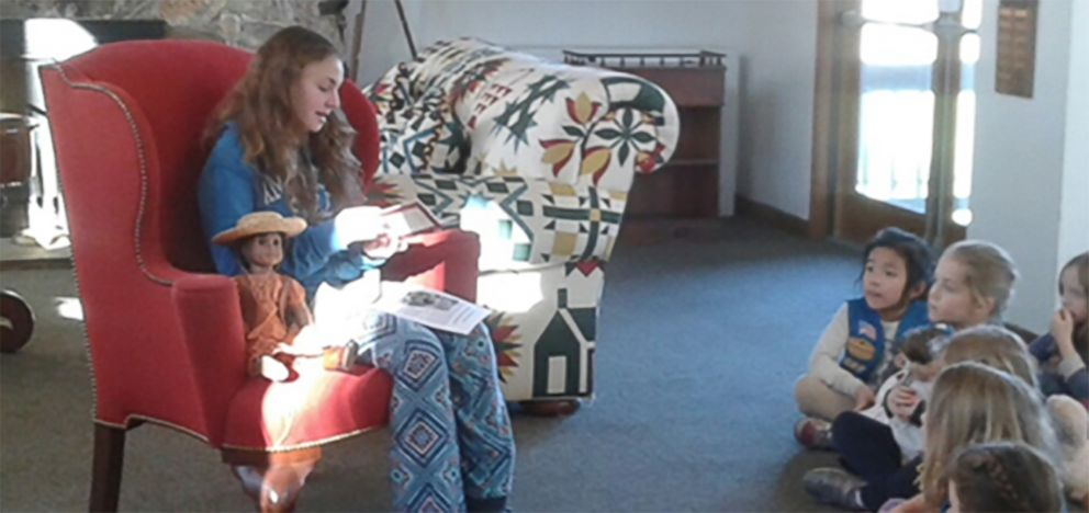 PHOTO: Olivia Reduto reads an American Girl story to younger Girl Scouts.
