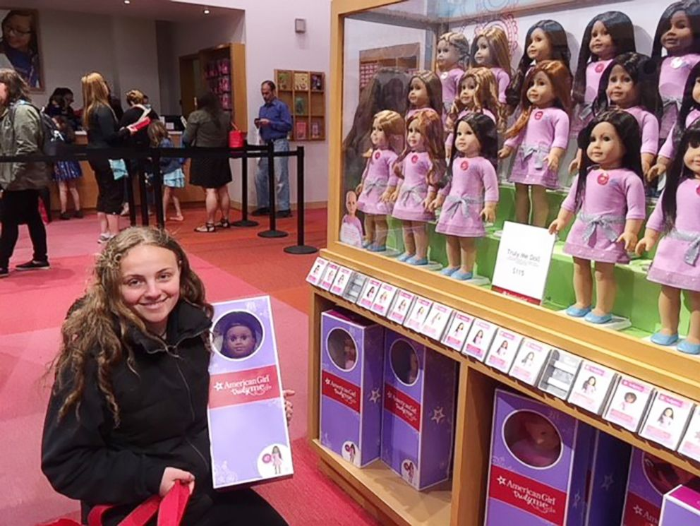 PHOTO: Olivia Reduto traveled to the American Girl store in New York City to purchase dolls for her local library.