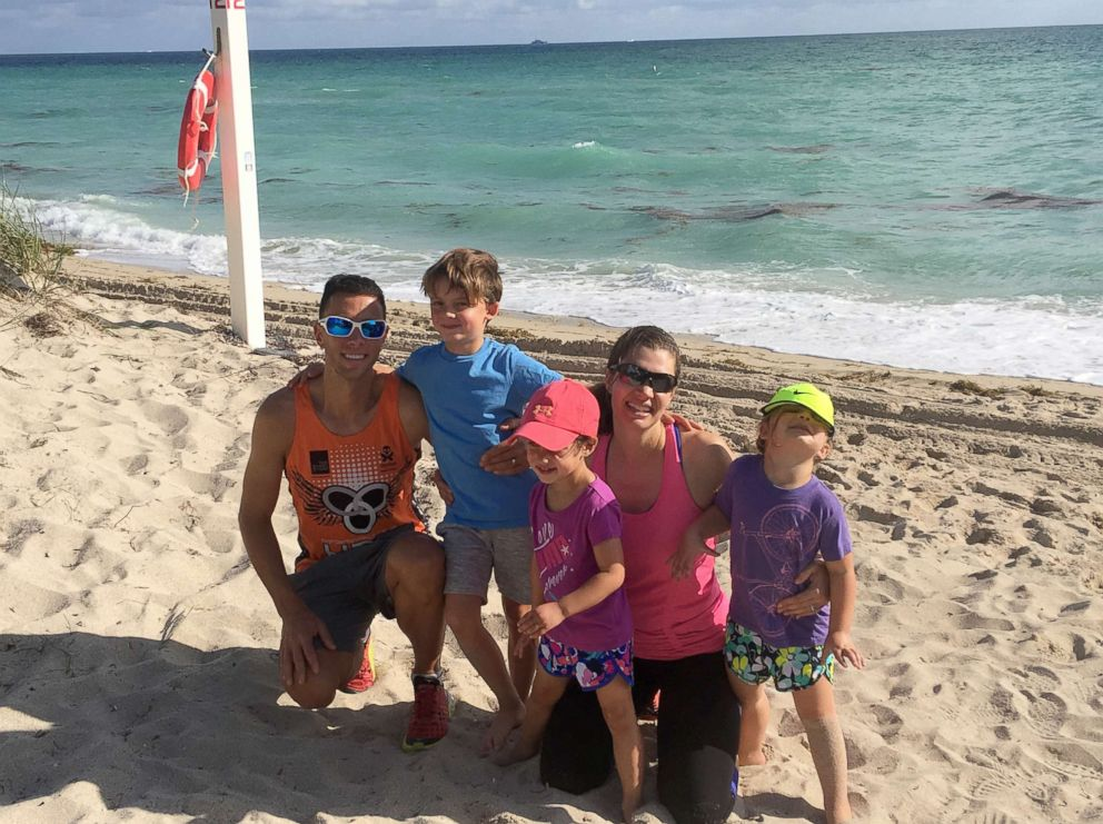 Dr. Anne Peled, smiles with her husband, Ziv, a fellow triathelete and runner, and their children, Simon, 7, and twins, Charlotte and Eveline, 4, at Miami Beach on Thanksgiving 2017, just before her diagnosis.