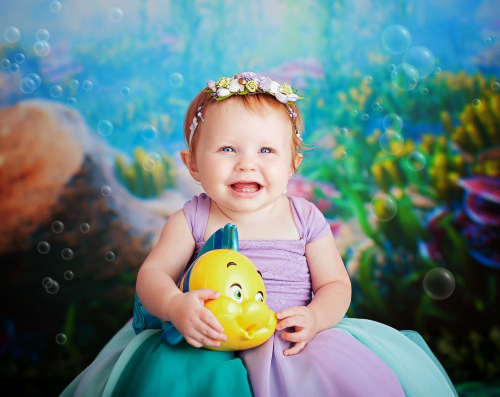 PHOTO: These babies who were photographed as newborn Disney princesses have reunited for a first-birthday cake smash.
