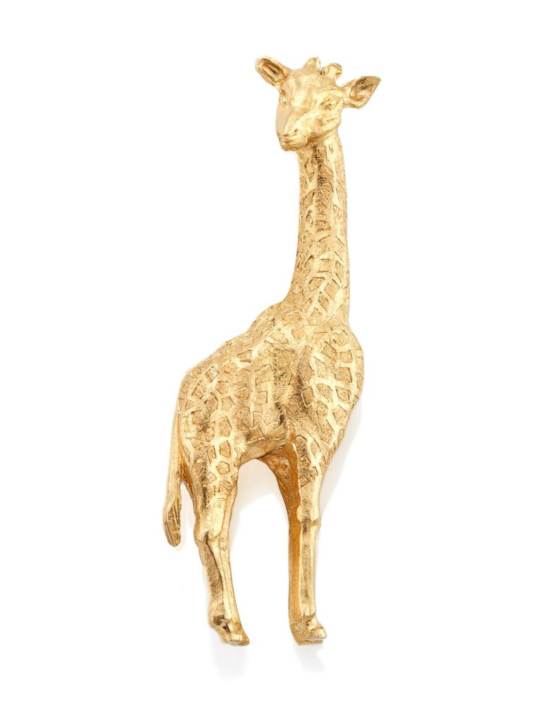 PHOTO: Seen in this photo, a novelty brooch by Cartier, once belonging to Audrey Hepburn. Modeled as a giraffe, the reverse side bears the inscription, Isnt it a small world? George.