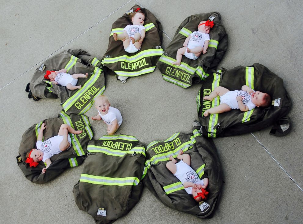 PHOTO: The ladder-men of Glenpool Fire Department in Glenpool, Oklahoma, posed with their kids on Sunday in a adorable photos snapped by Avery Dykes, who is mom to the oldest baby in the bunch.