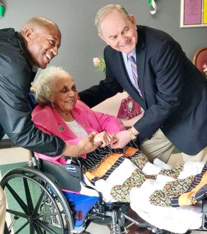 PHOTO: Danville Mayor John Gilstrap and Vice Mayor Alonzo Jones flank Avicia Thorpe at her birthday party inside the Stratford Rehabilitation Center in Danville, Va., April 16, 2018.