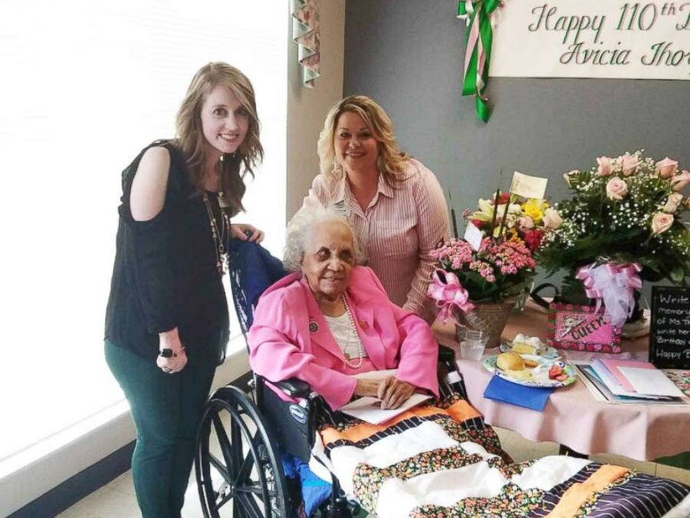 PHOTO: Stratford Activities Director Kim Holley and Director of Nursing Karen Baise flank Avicia Thorpe while posing for a photo at her birthday celebration in Danville, Va., April 16, 2018.