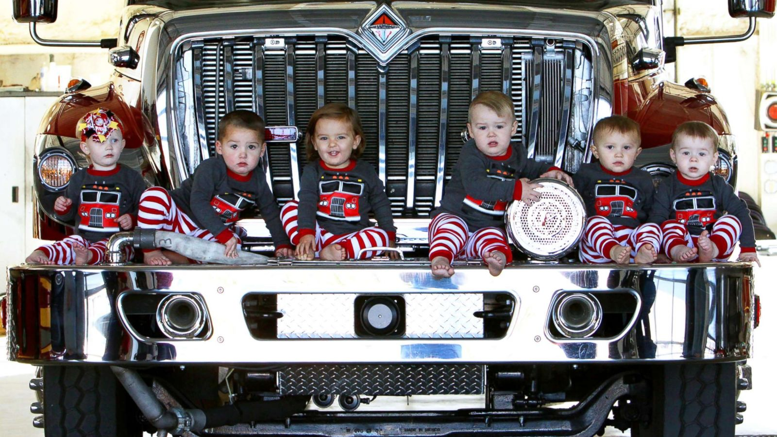 6 babies born within months re-create fire station Christmas card ...