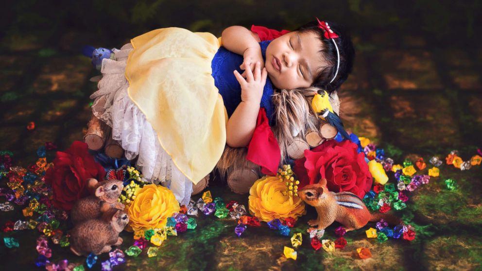 A photographer turned newborn babies into Disney princesses for a magical photo shoot.