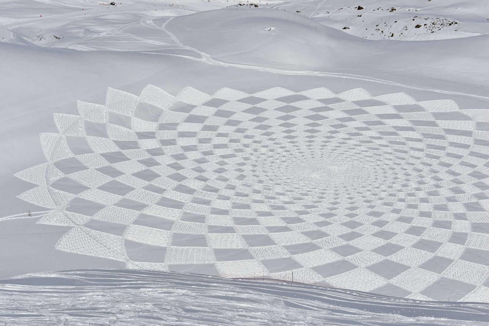 Artist creates massive murals in snow all over the world