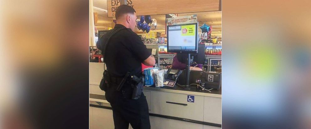 PHOTO: Rookie Laurel police officer Bennett Johns bought diapers for a woman caught shoplifting in order to care for her, July 22, 2017.