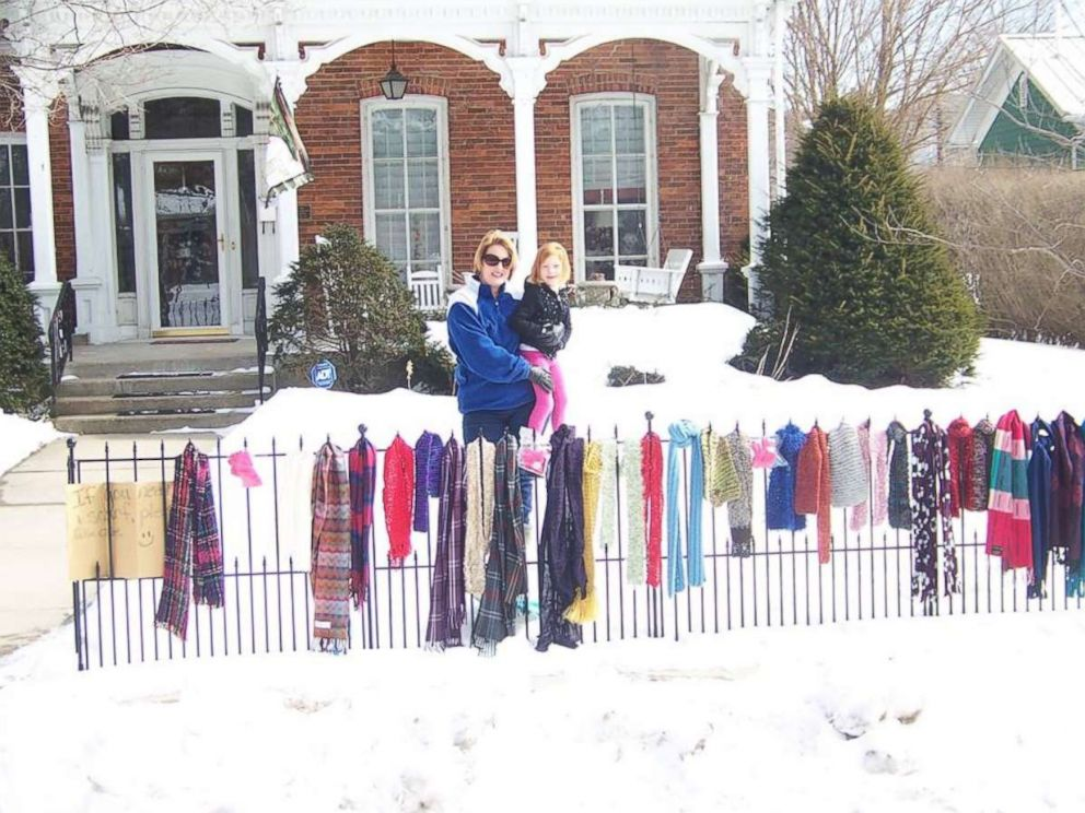 PHOTO: Lynda Salisbury and her daughter, Olivia, pose with their blessing fence in front of their Goshen, Ind., home.
