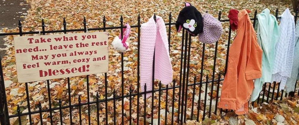 """PHOTO: Lynda Salisbury of Goshen, Indiana, is providing warm clothing for the needy on a """"blessing fence"""" at her home.z"""