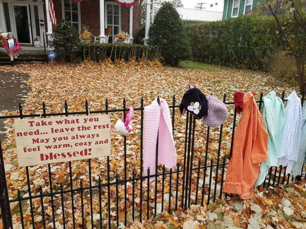 PHOTO: Lynda Salisbury of Goshen, Indiana, is providing warm clothing for the needy on a blessing fence at her home.z