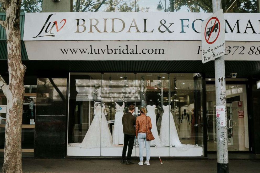 PHOTO: Blind bride Stephanie Agnew with her brother Cal at Luv Bridal in South Melbourne, Victoria, Australia.