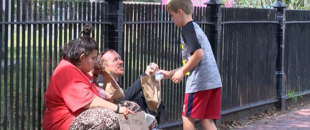 PHOTO: Liam Hannon, 10, hands out homemade lunches to the homeless population of Cambridge, Massachusetts, along with help from his father, Scott Hannon.