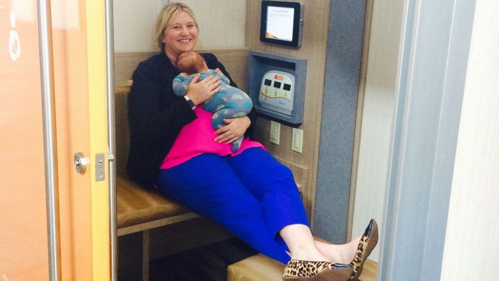 Stephanie Conduff sits inside a Leche Lactation suite with her son, Guthrie.