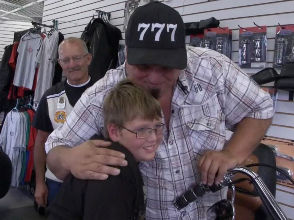 PHOTO: Phil Mick, 11, seen with Brett Warfield, sales manager of KDZ Motorcycle Sales & Service, who organized an escort ride for the boy to his first day of middle school on Aug. 1.