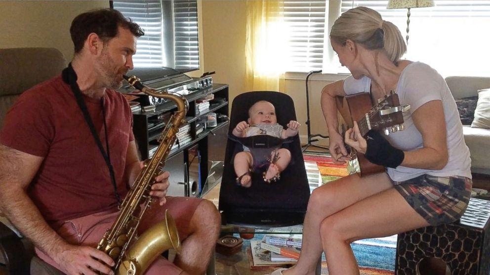 Bronkar and Cyndi Lee of Atlanta, Ga., play instruments with their 19-month-old son Elijah.